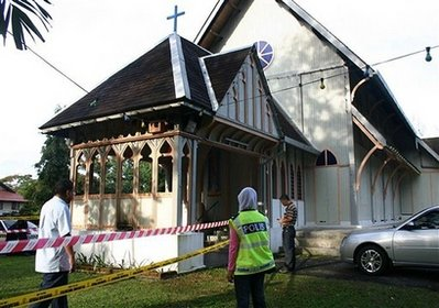 Police officers inspect damage at the All Saints Church in Taiping of Perak state, Malaysia, Sunday, Jan. 10, 2010. Another church was hit by a firebomb early Sunday, the fifth assault in three days of unrest following a court decision that allows Christians and other non-Muslims to use 'Allah' to refer to God.