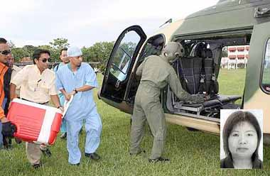 Special delivery: Doctors rushing to place organs donated by Chiew (pic) onto a helicopter yesterday.