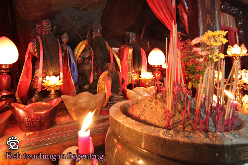 Incense sticks offered by the prayers to the gods of the temple