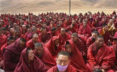 Tibetan monks attend a mass prayer for earthquake victims in the quake-hit Gyegu town of Yushu county, Qinghai province April 20, 2010. China will hold a national day of mourning for victims of an earthquake in the country's western region, the government announced on Tuesday, as the official death toll from the disaster climbed to 2,039, state media reported. REUTERS/Stringer