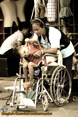 A less fortunate child and his mother at the Chatuchak weekend market