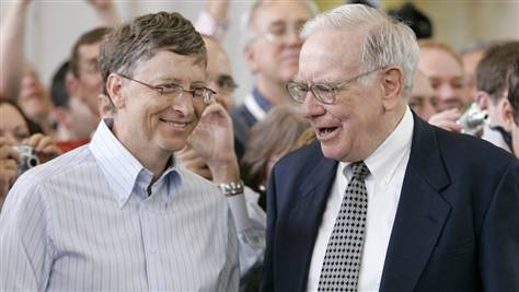Bill Gates, left, and Warren Buffett, seen in this 2007 photo during the annual Berkshire Hathaway shareholders meeting in Omaha, are trying to persuade other American billionaires to give at least half their wealth to charity.