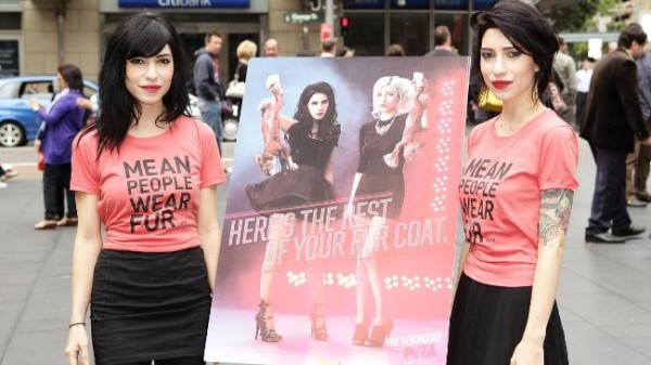 Jess and Lisa Origliasso of The Veronicas at a public event unveiling their new PETA ad. (Photo: Brendon Thorne/Getty)