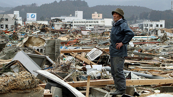 A man surveys the damage in Minami Sanriku, a town in Miyago Prefecture, on Tuesday, March 15. (AFP/Getty photo)
