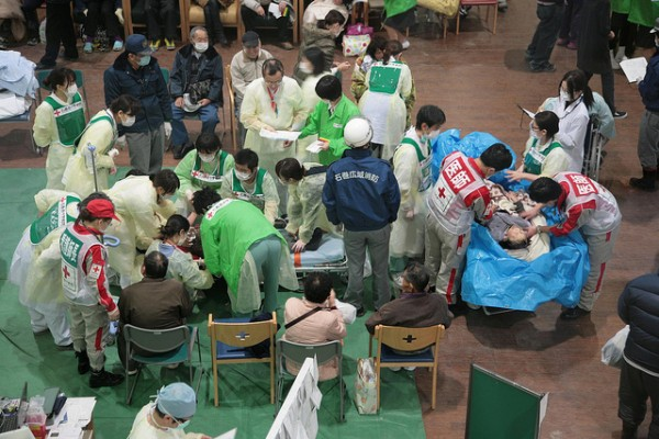 Those who have suffered near drowning are wrapped in blankets and then plastic sheeting to keep them both warm ad dry before being transported to Ishinomaki Red Cross hospital for treatment. (Photograph: Toshirharu Kato, Japanese Red Cross)