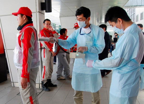 Technicians scan Red Cross rescue workers for signs of radiation in Nagahama City, Shiga Prefecture in northern Japan, after an earthquake and tsunami struck the area, March 14, 2011. (Photograph: Reuters/Kyodo)