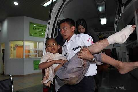One of the injured children being taken into Ampang Hospital after the landslide at Rumah Anak Yatim Hidayah in Hulu Langat (photo from thestar.com.my)