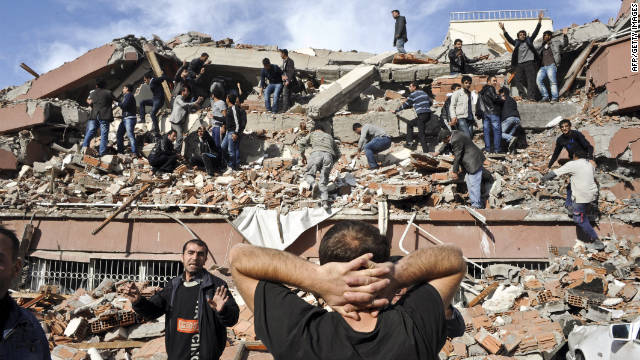 The quake caused several buildings in Ercis to collapse, trapping an unknown number of citizens in the debris.