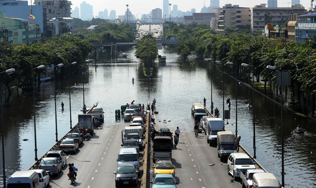 A main road is cut off by the flooding in Bangkok (photo from news.sky.com)