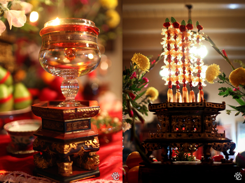 oil lamp (left); bamboo skewers of preserved papaya and cherries on top of the chanab as offering (right)