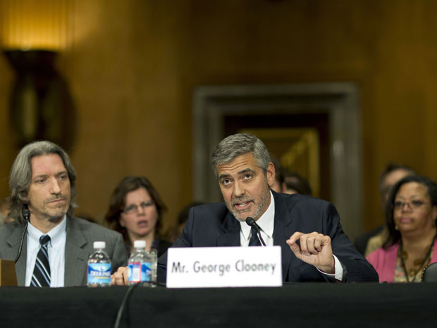 Clooney testifies during a Senate Foreign Relations Committee hearing next to John Prendergast, co-founder of the Satellite Sentinel Project, regarding Sudan at the Dirksen Senate Office Building in Washington Wednesday. (photo: REUTERS/Benjamin Myers)