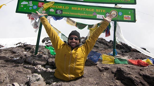 Double amputee Spencer West reaches peak of Mount Kilimanjaro, June 19, 2012, in Tanzania. (image from Free The Children/PRNewsFoto)