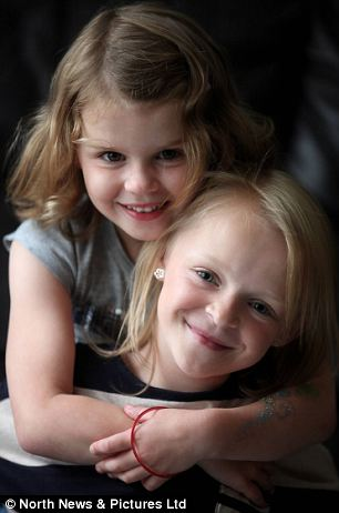 Emily Clark, 9, (right) pictured with little sister Lily has one functioning kidney