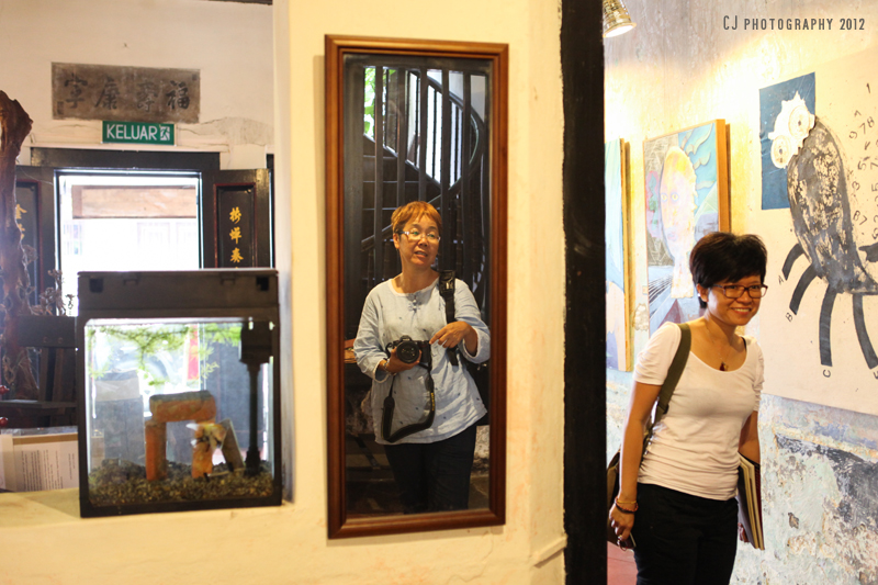 Sister Bi-Qing (in the mirror) and friend at Baboon House
