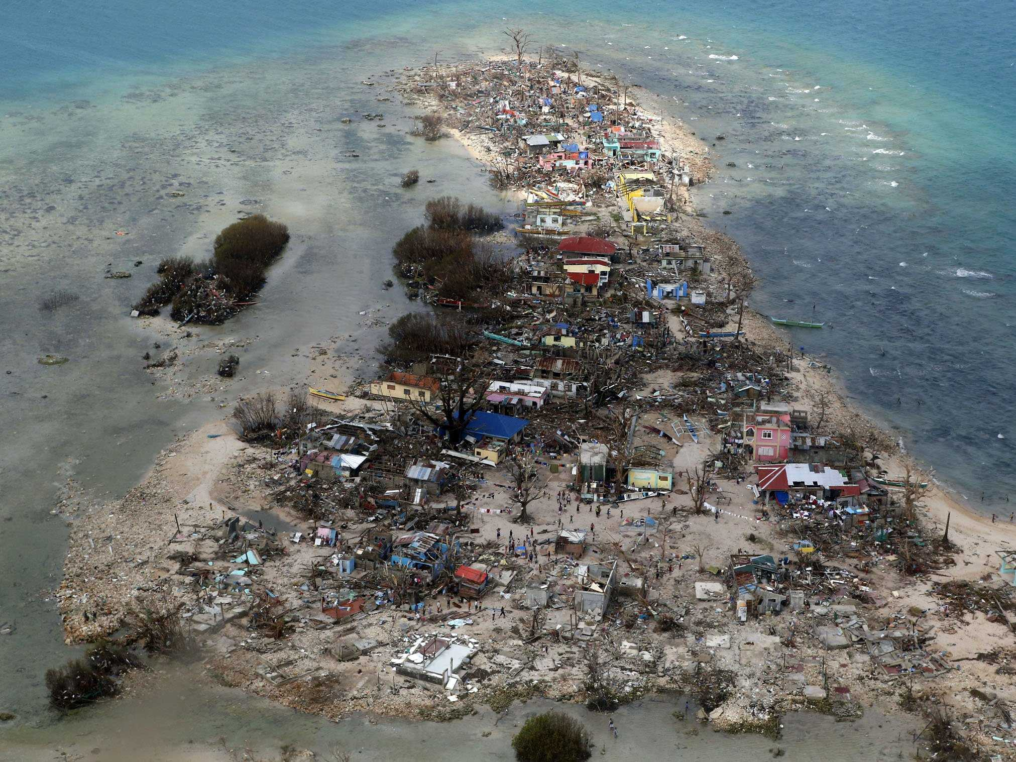 An aerial view of a coastal town, devastated by super Typhoon Haiyan, in Samar province in central Philippines November 11, 2013. Dazed survivors of super Typhoon Haiyan that swept through the central Philippines killing an estimated 10,000 people begged for help and scavenged for food, water and medicine on Monday, threatening to overwhelm military and rescue resources. (image by REUTERS/Erik De Castro)