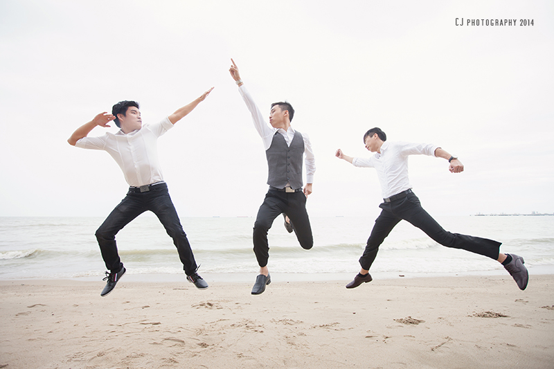 Groomsmen and groom's jump shot