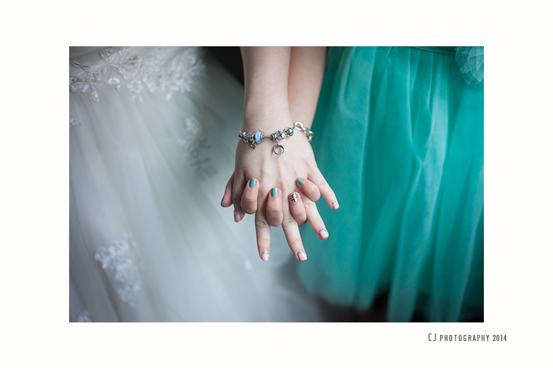 Soft color and cute manicure on the fingers of bride and sister