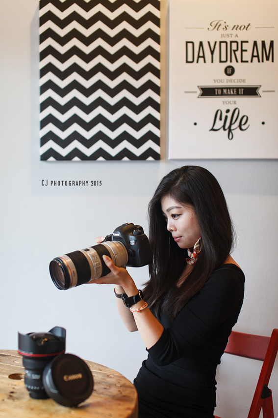 Vna with her favorite camera (shot with Canon EOS 5D Mark II with Sigma's 50mm f/1.4 EX DG HSM lens)