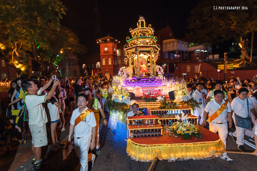 One of the float from Seck Kia Eenh Buddhist Temple passing by the iconic Clock Tower outside Stadthuys of Melaka