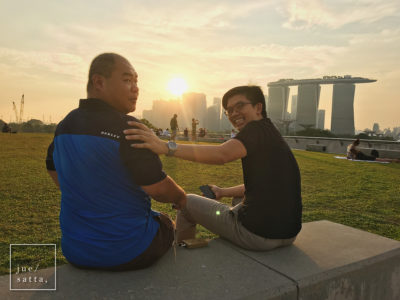Henry (left) and Koh Yiaw enjoying sunset at the rooftop park of Marina Barrage